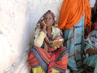 A Somalian woman carrying a child