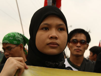 A Muslim woman joins a protest in Manila, Philippines