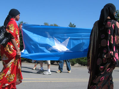 Two women carry the Somali flag